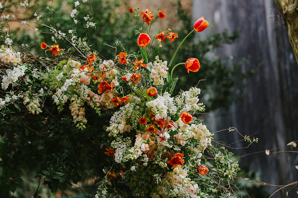 Detail of the floral arch that served as the ceremony altar. Photo: Ashley Biltz
