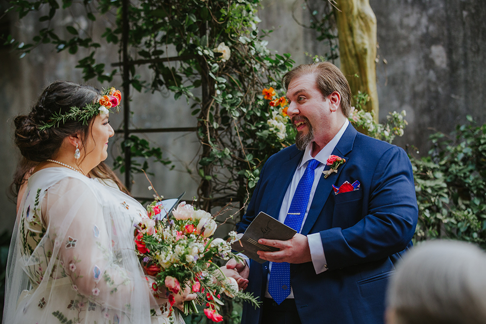 Peter and Del read their vows from folios personalized with their wedding date. Photo: Ashley Biltz