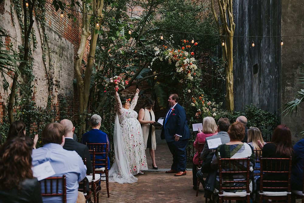 Del celebrates after saying her vows to Peter. Photo: Ashley Biltz