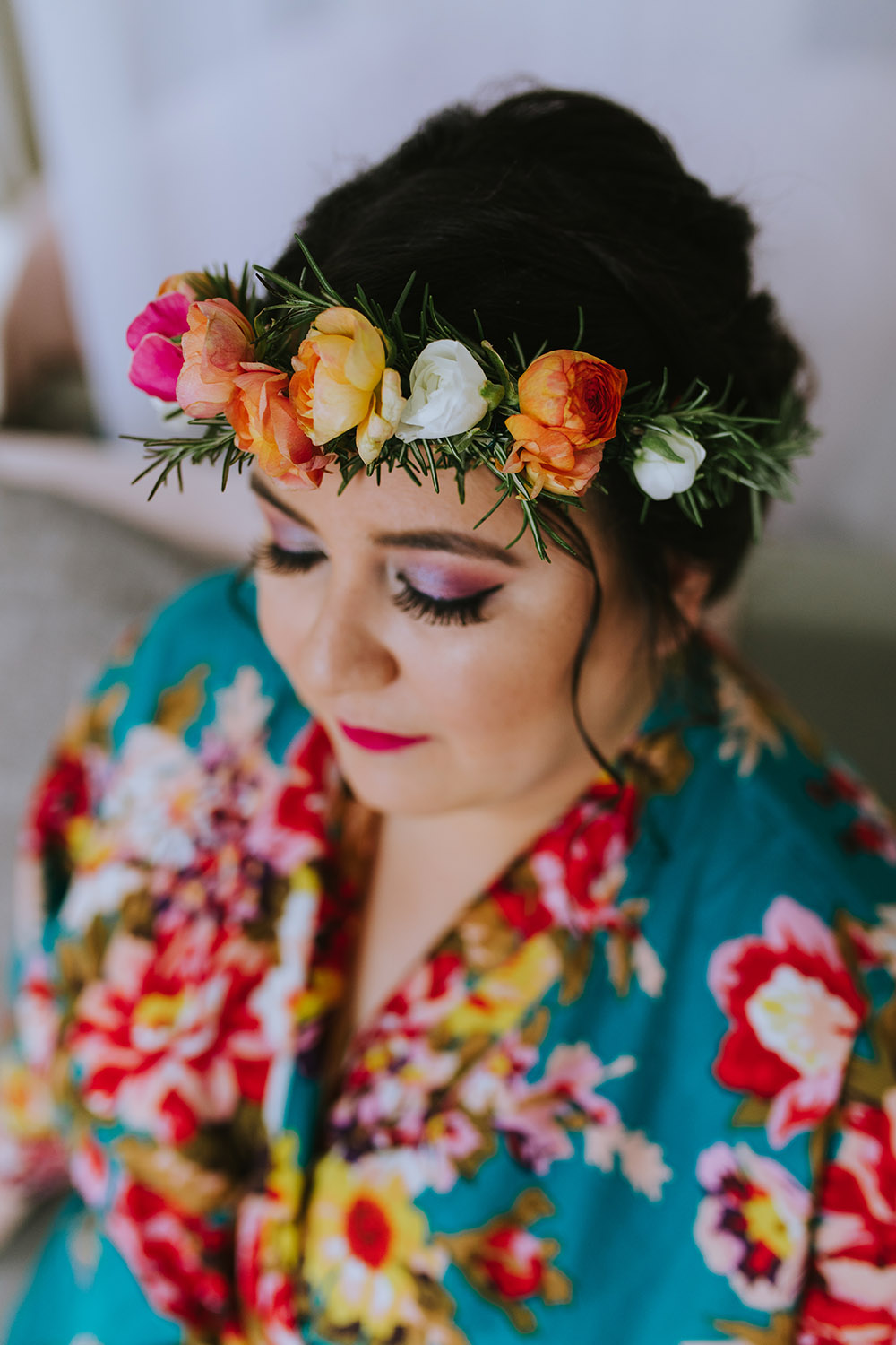 Pistil and Stamen created a floral wreath headpiece for Del including orange, yellow, pink and ivory blooms with sprigs of rosemary. Photo: Ashley Biltz