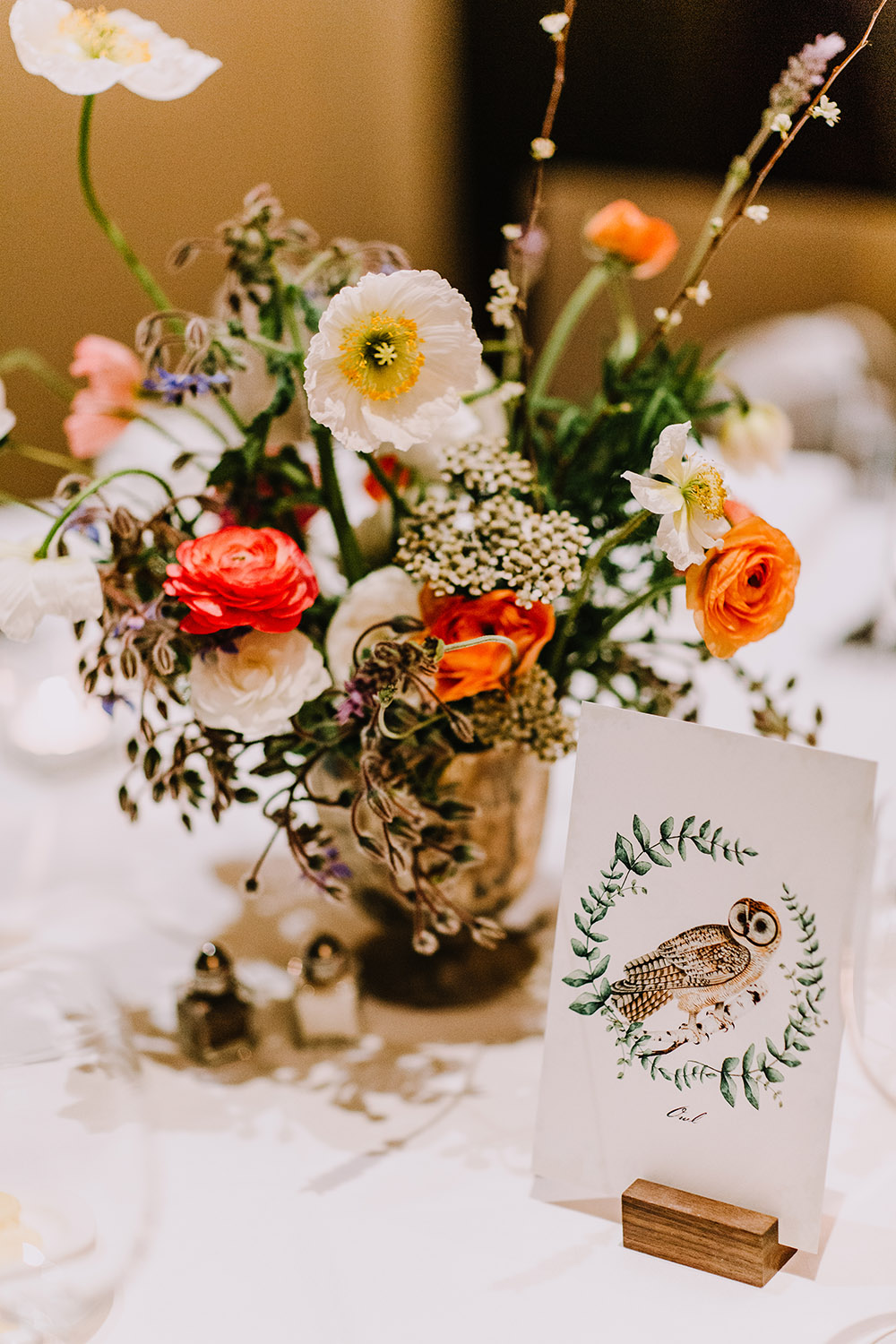 Arrangements of wildflowers graced the tables at the reception. Photo: Ashley Biltz