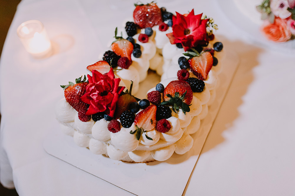 Berry Chantilly Cakes in the Couple's monogram accompanied the traditional wedding cake. Photo: Ashley Biltz