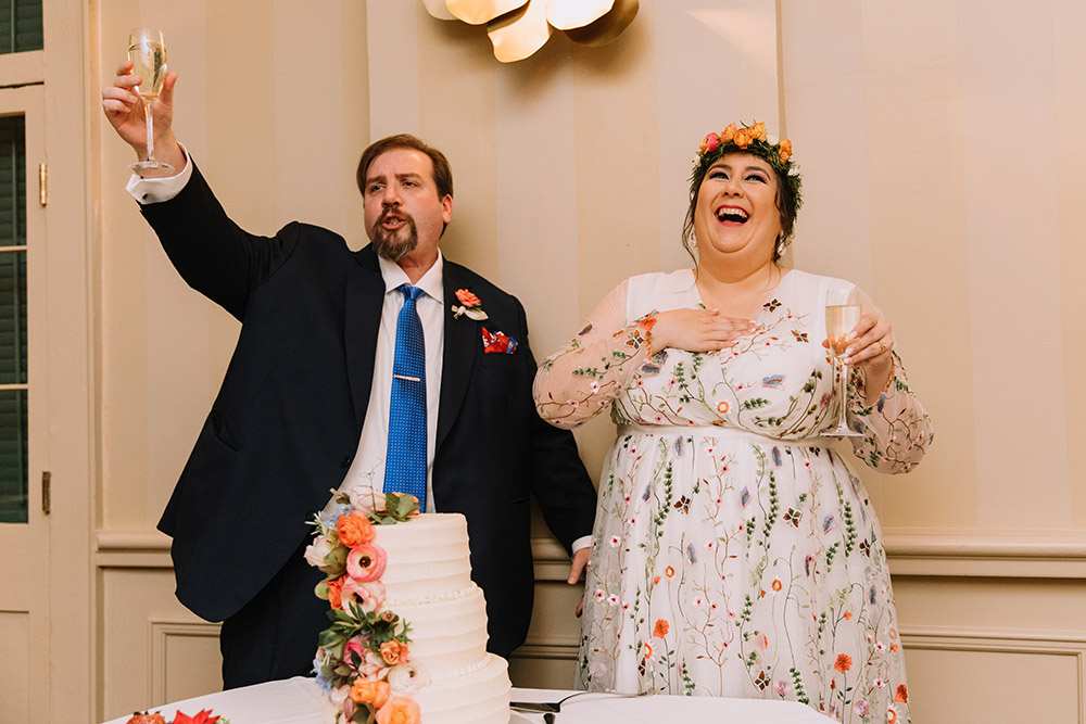 Del and Peter toast their guests during the cake cutting at their reception. Photo: Ashley Biltz