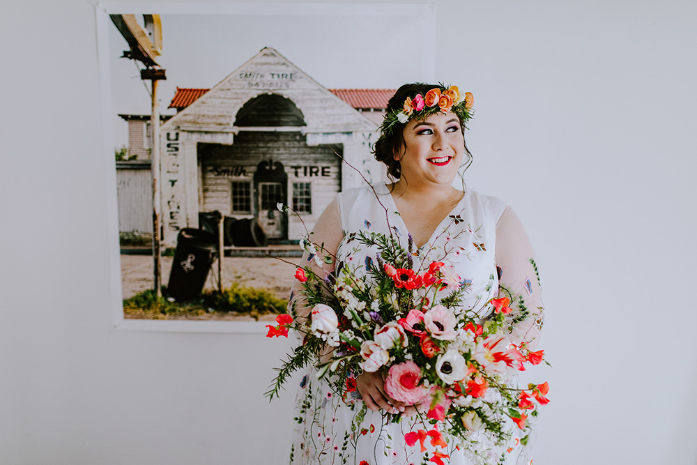 Del poses with her stunning bridal bouquet by Pistil and Stamen. Photo: Ashley Biltz