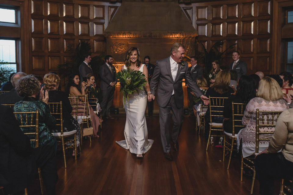 Newlyweds walk down the aisle for their wedding ceremony recessional. Photo: The Swansons
