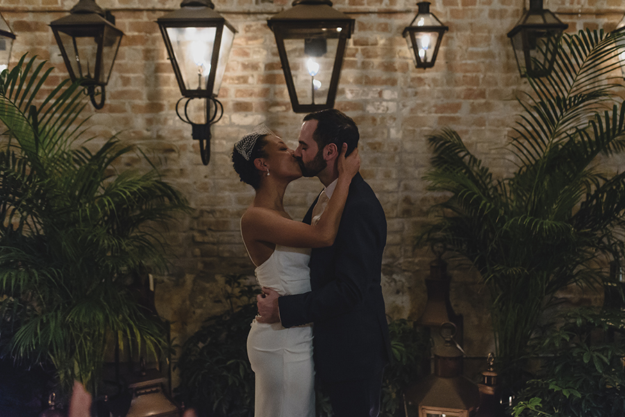 Newlyweds Kiss During Their Wedding Ceremony At Bevolo In New Orleans. Photo: The Swansons