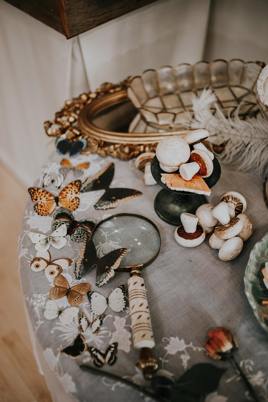 Butterflies and meringue mushrooms.