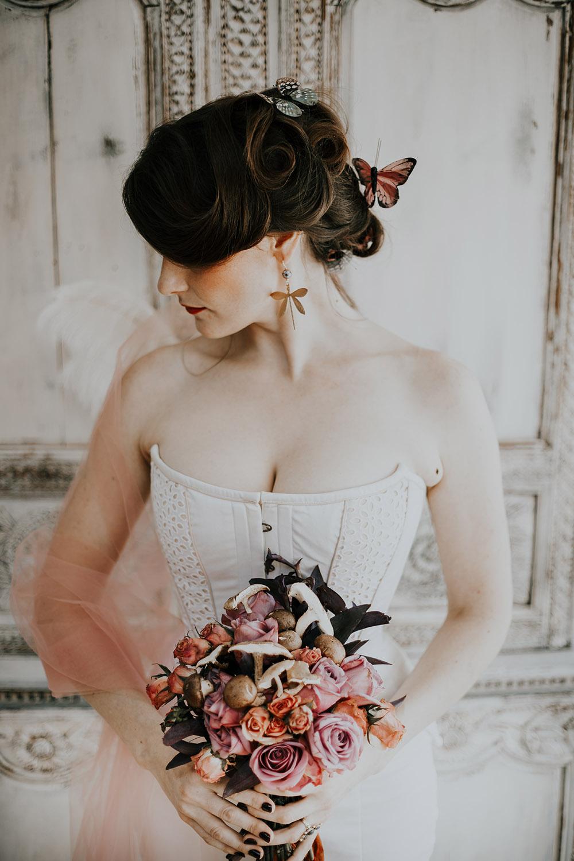 "Butterflies ""land"" in the bride's updo."
