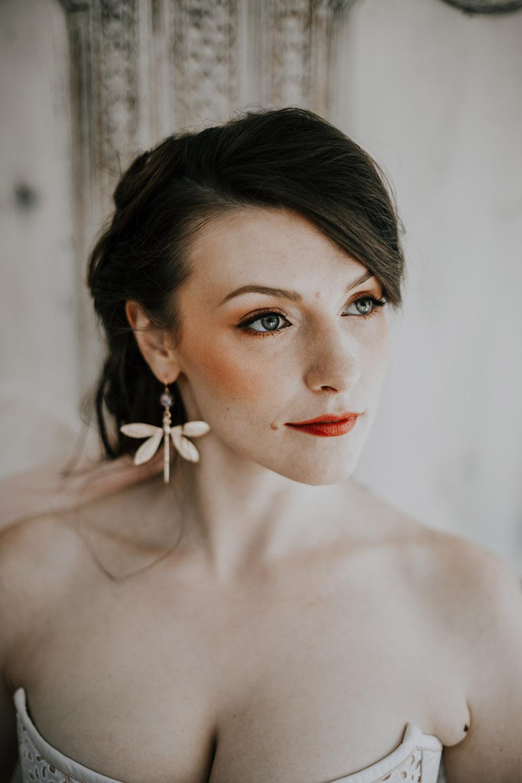 Bride wearing dragonfly earrings