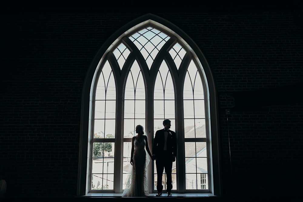 Ashley and Peter pose in the arched window's of Felicity Church's choir loft.