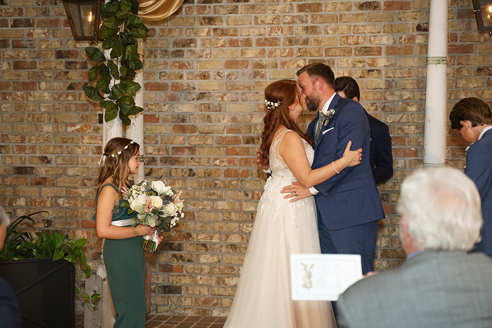 Allison and Todd kiss as they're pronounced husband and wife.