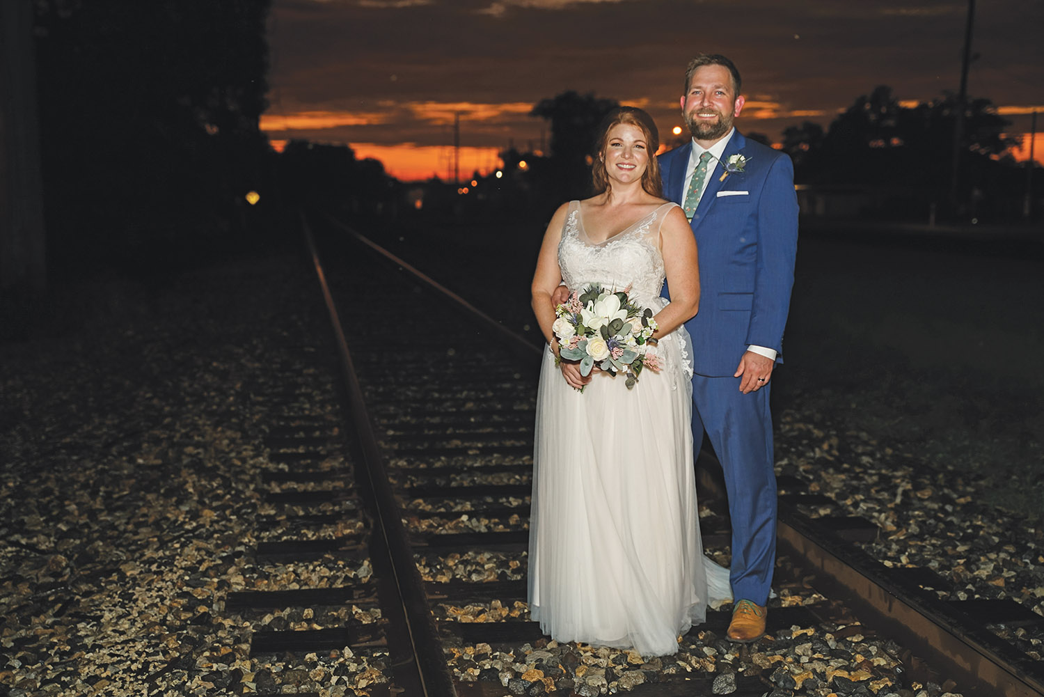 Allison And Todd Pose On The Train Tracks Near The Crossing
