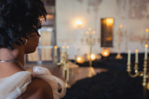 The bride pauses at the end of the aisle. Photo: Brian Jarreau Photography