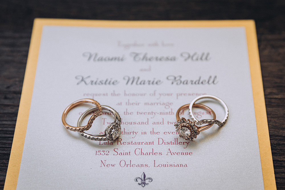 Naomi and Kristie's rings on their wedding invitation