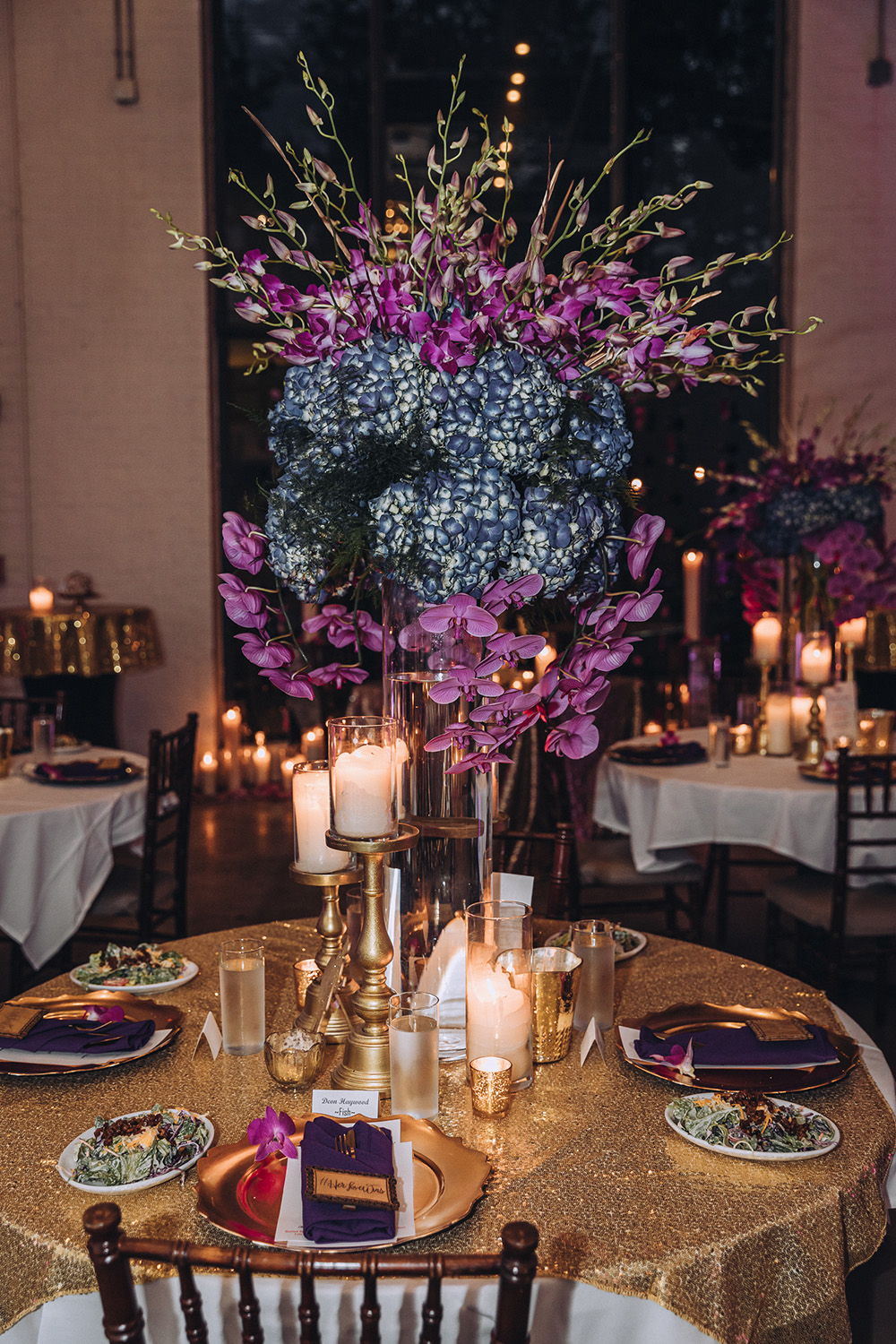 Pink and purple floral arrangements graced the reception tables.