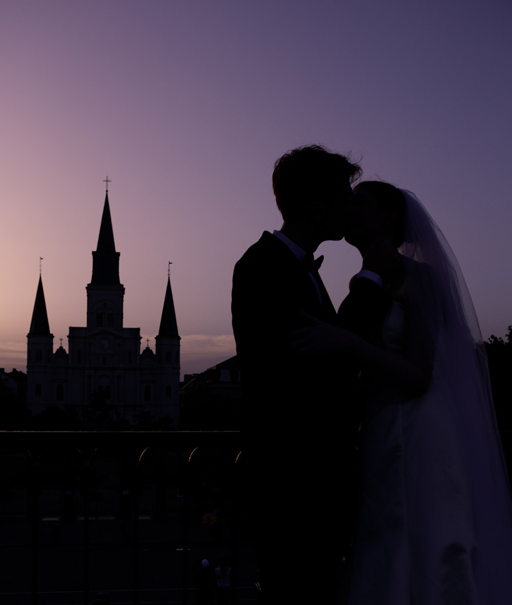 Silhouette of a bride and groom with the St. Louis Cathedral in the background