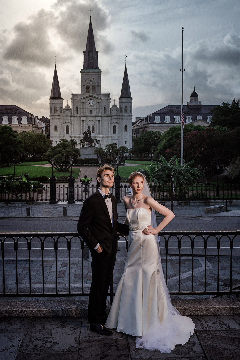 A bride and groom in front of the St. Louis Cathedral in New Orleans