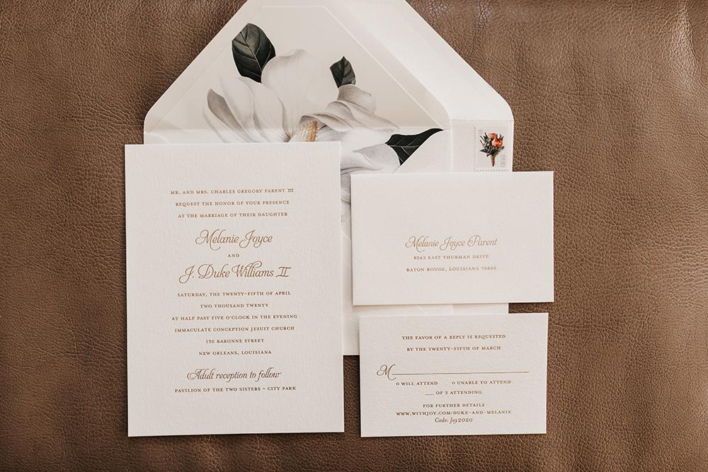The invitation suite featuring a Magnolia motif.