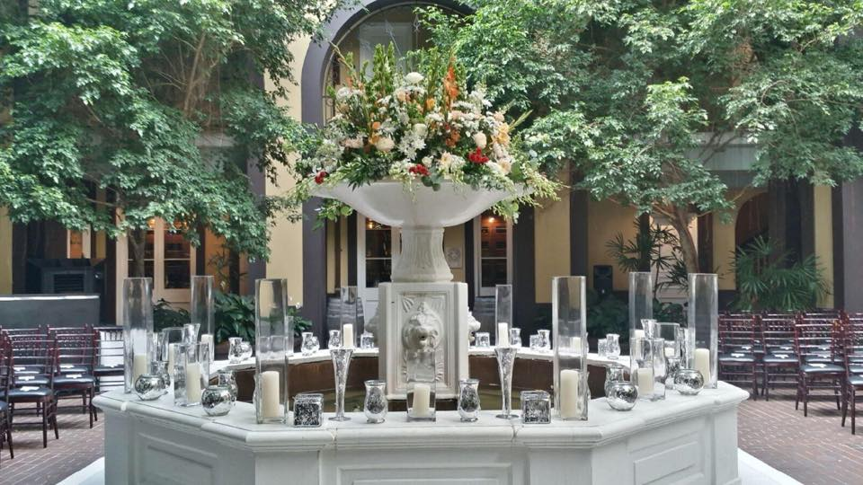 Hotel Mazarin Courtyard Fountain with Floral and Candle Decor