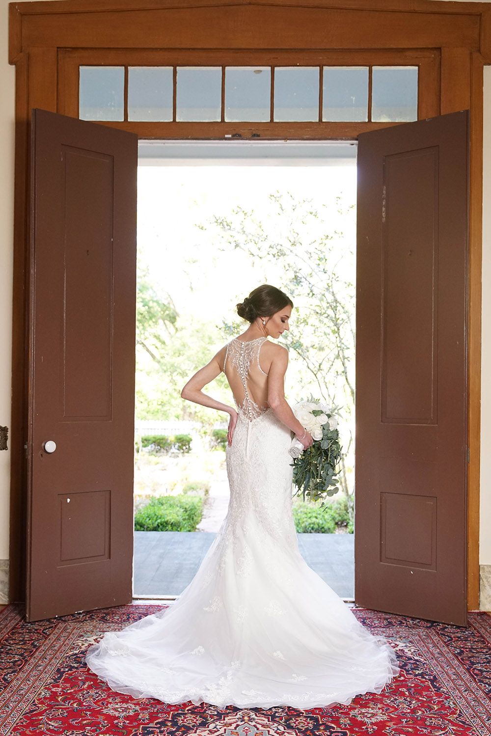 A bridal portrait in the doorway of a home