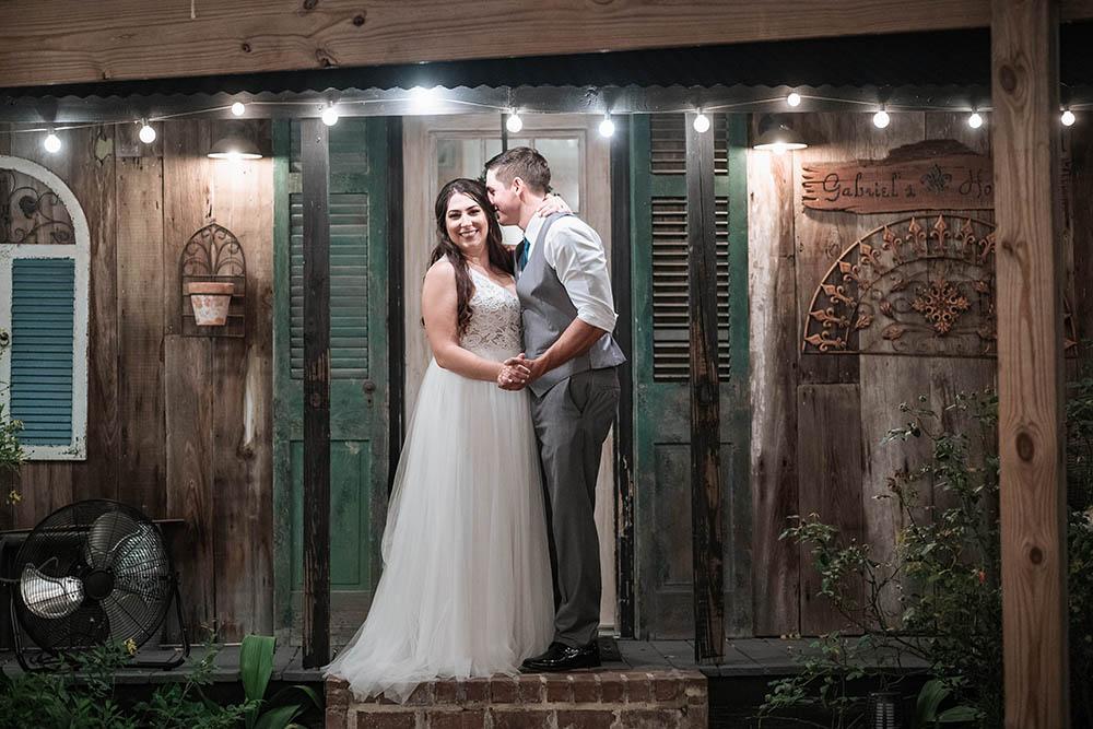 A bride and groom at a cajun camp.
