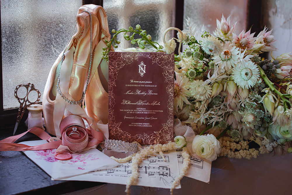 Wedding details including invitation, jewelry and the bouquet.