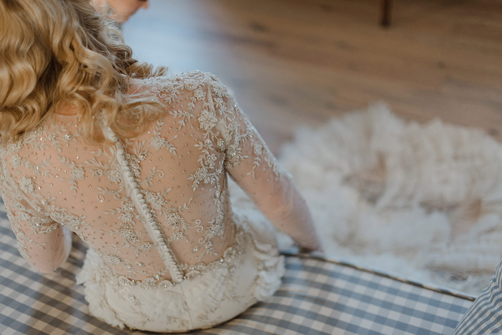 Back detail of Chelsea's Lazaro wedding gown.