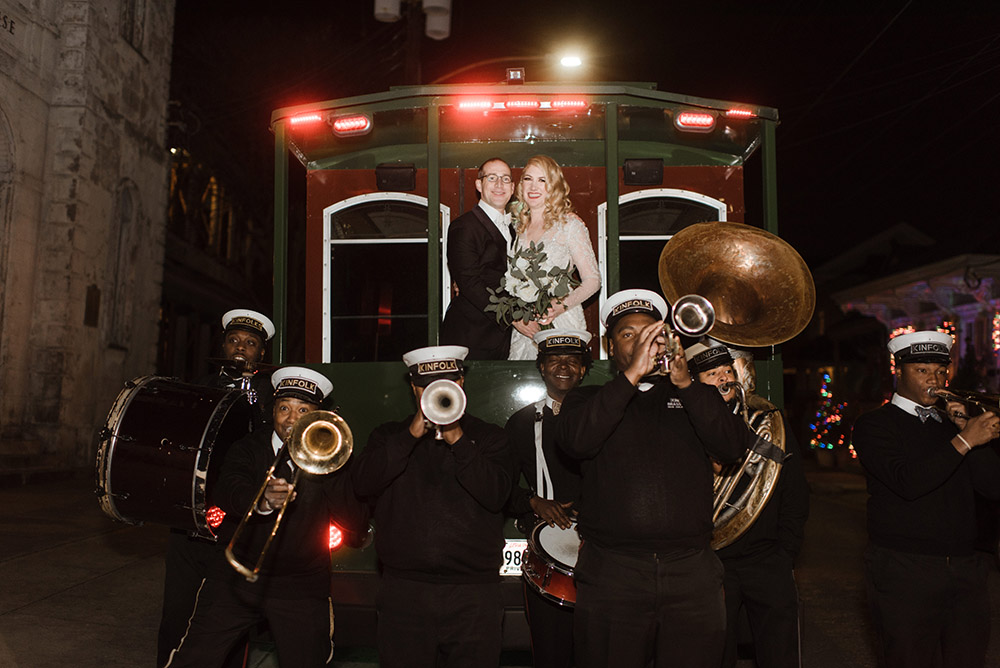 Chelsea and Ross pose for a portrait on a Trolley with Kinfolk Brass Band.