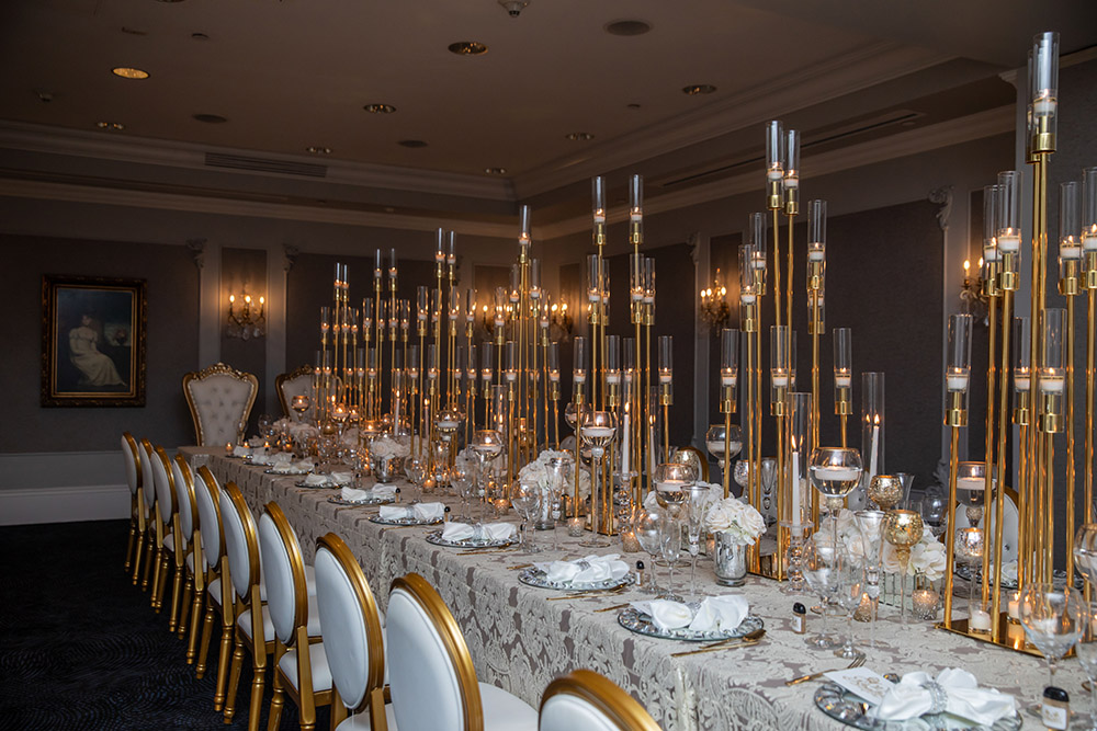 The engagement party dinner table with modern, elegant candelabra.