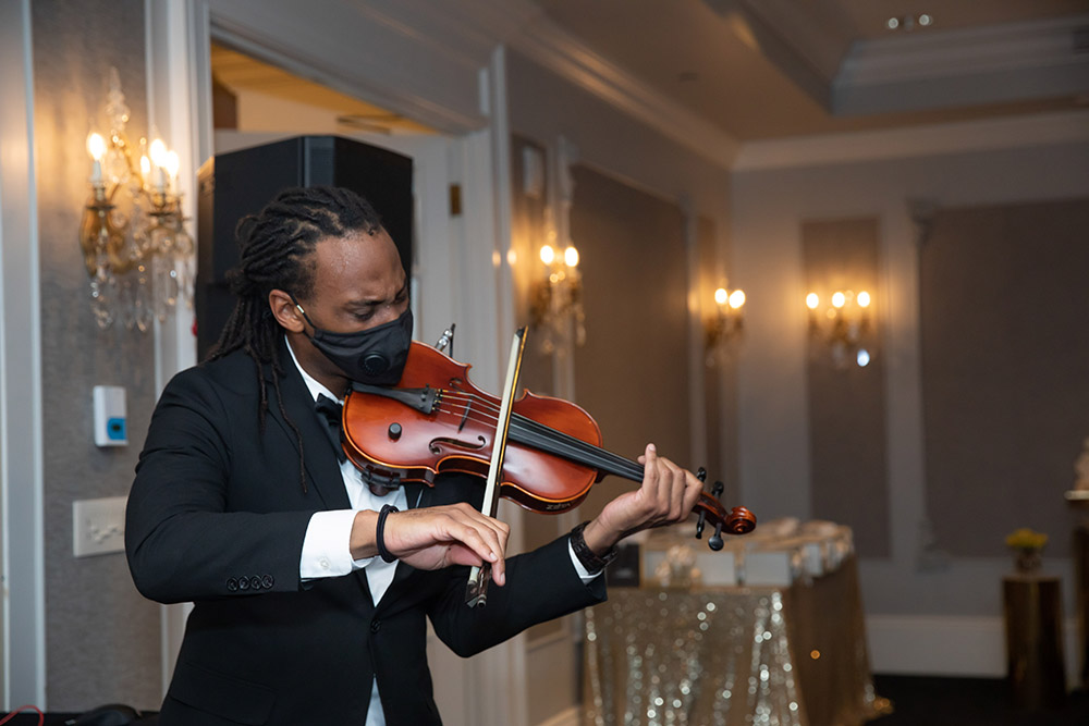T-Ray the Violinist performs at Shonathan and Desmond's engagement party.
