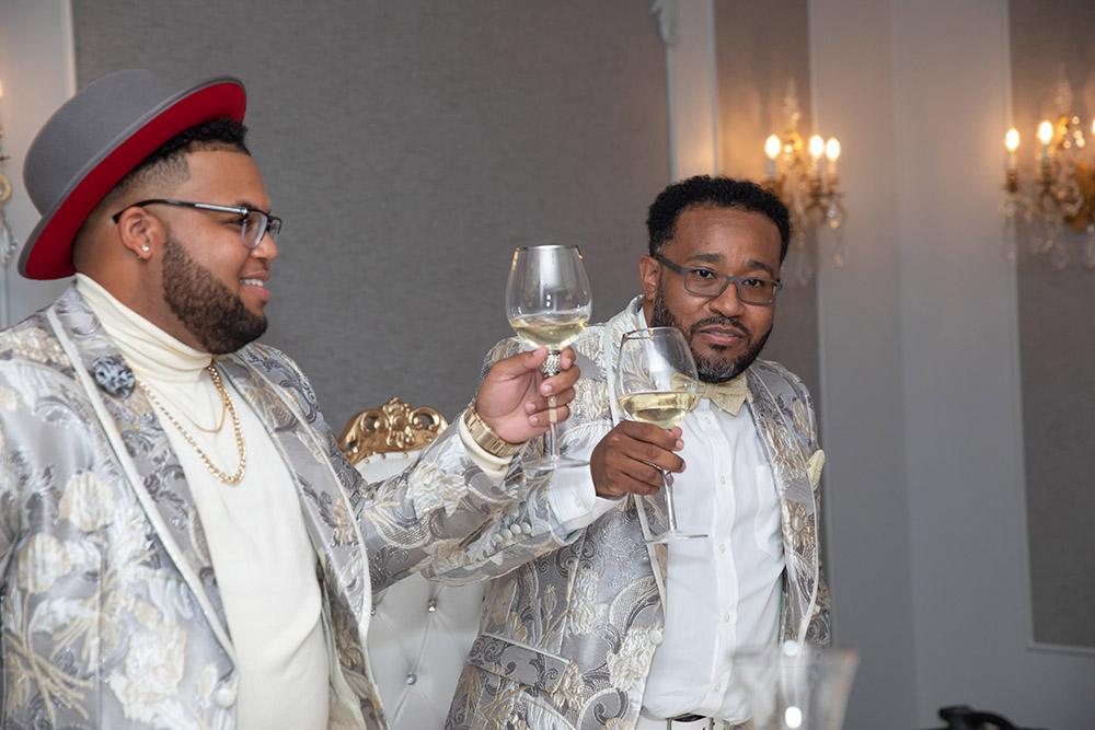 Shonathan and Desmond toast their guests.