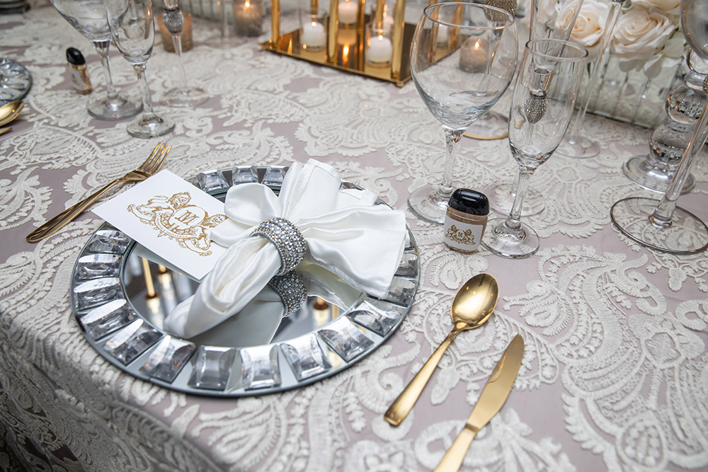 Place setting in silver and gold.