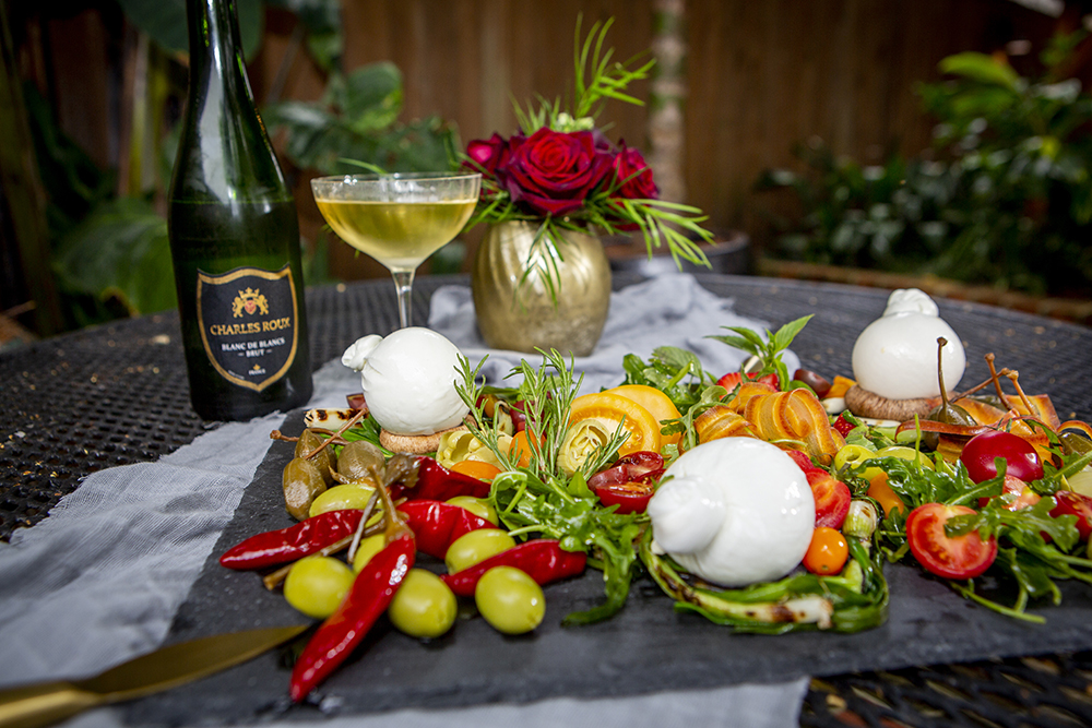 Burrata with an assortment of toppings and ciabatta croutons, served with Champagne
