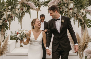 """Jordan and Adam celebrate after they say """"I do"""""""