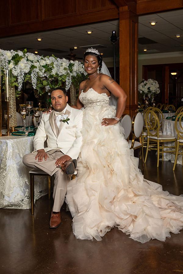 Bride and groom pose at wedding reception