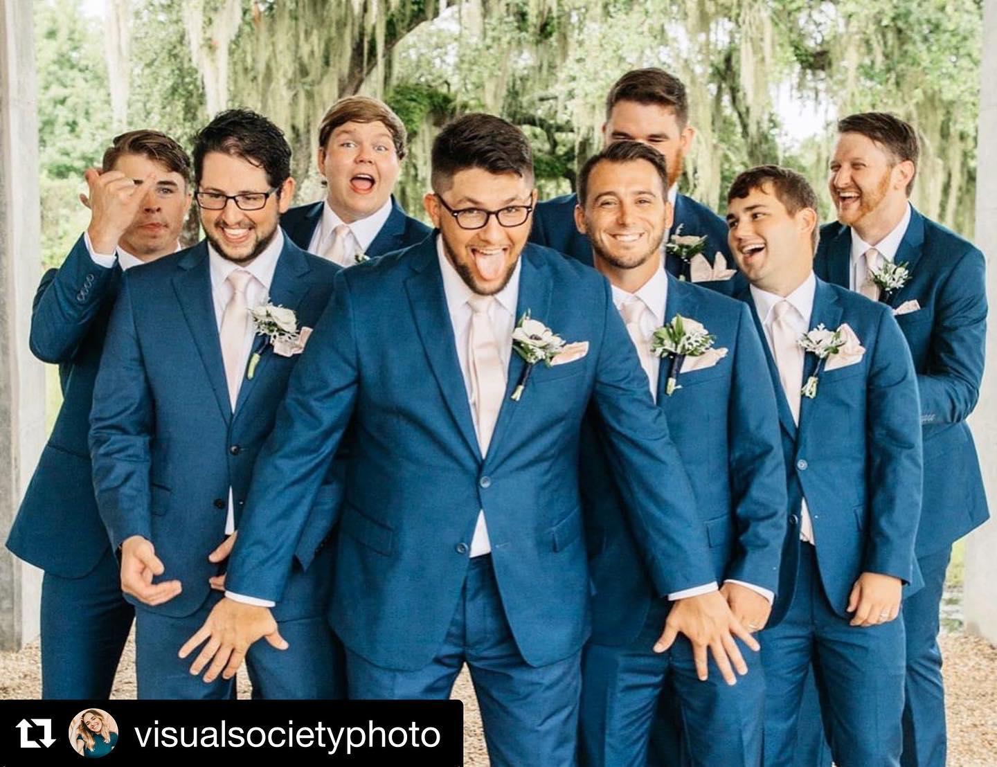 Groom and groomsmen in slate blue tuxedos from Tuxedos to Geaux