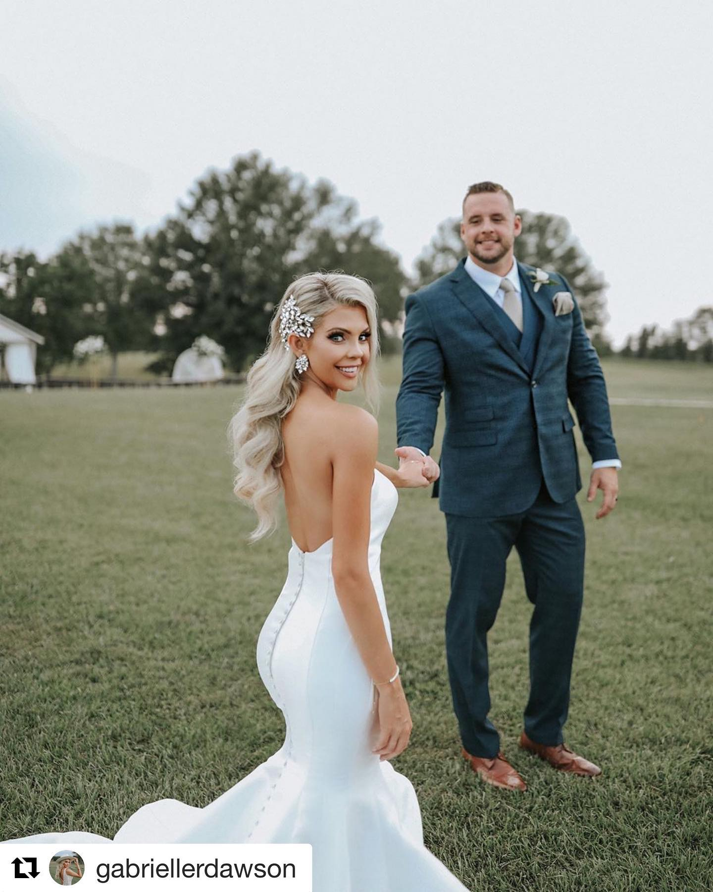 Bride with groom in slate blue tuxedo from Tuxedos to Geaux