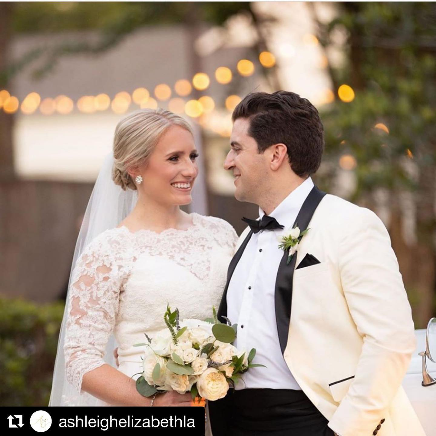 Bride with Groom in ivory and black shawl tuxedo from Tuxedos to Geaux
