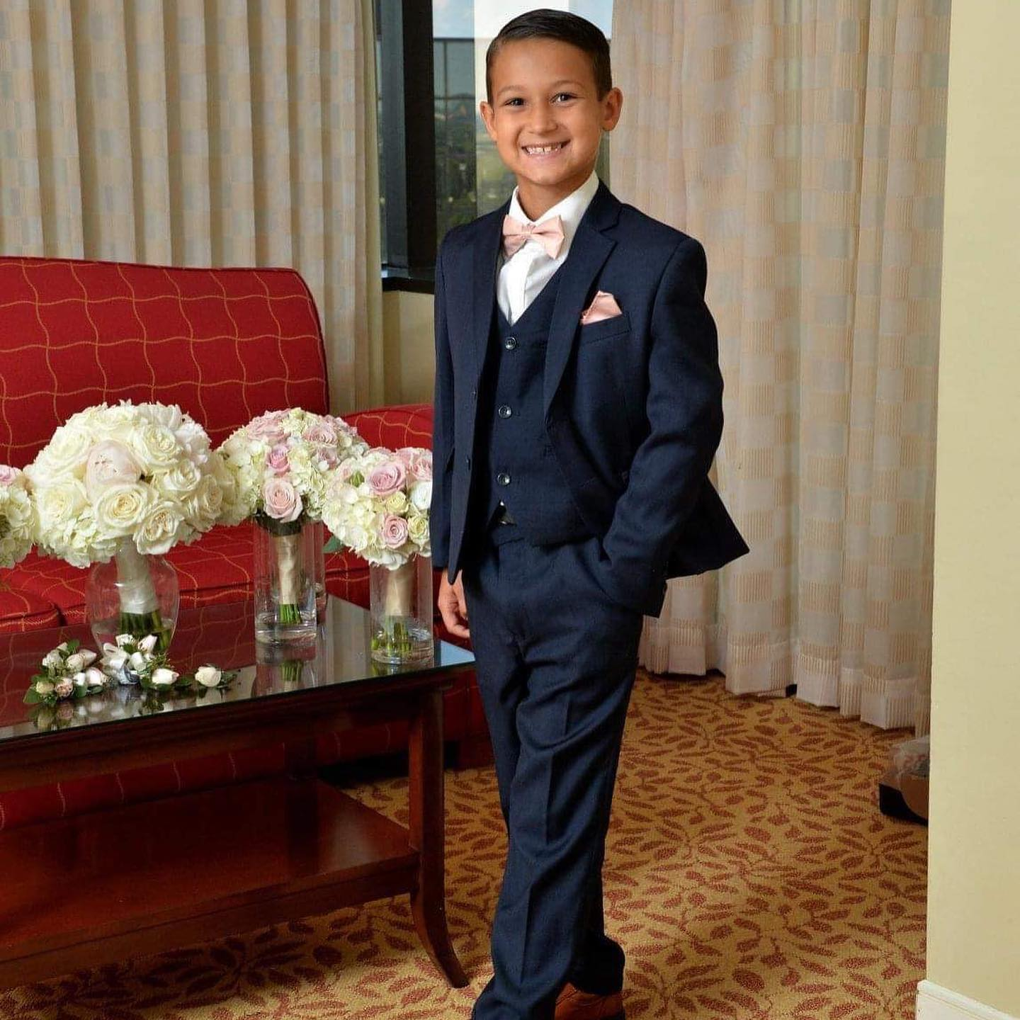 Ring bearer in navy tuxedo from Tuxedos to Geaux