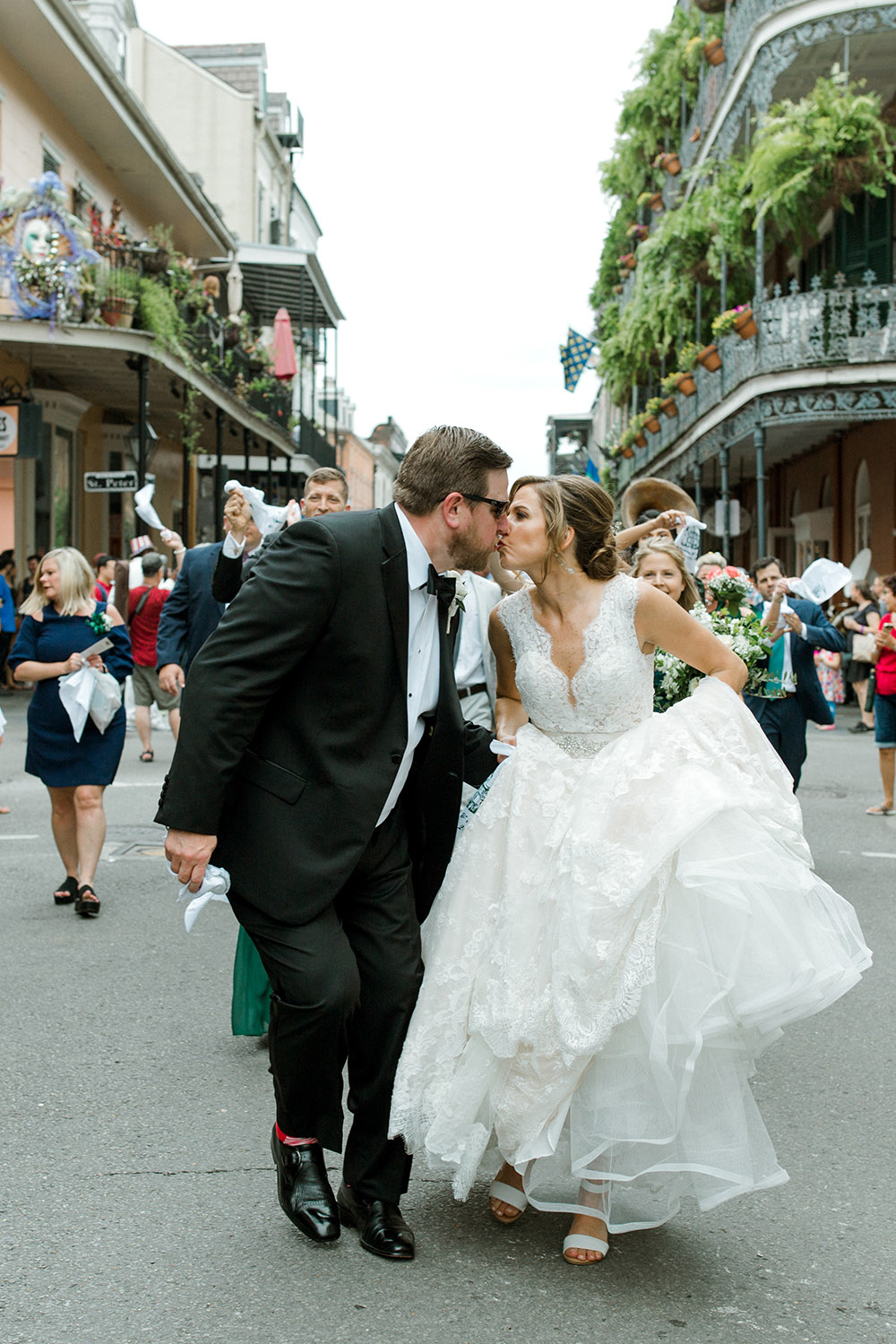 Bride and groom kiss in the French Quarter