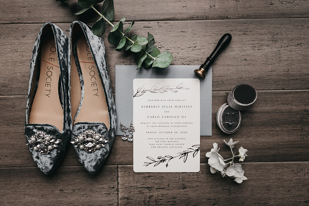 The wedding invitation with Kimberly's shoes and ring