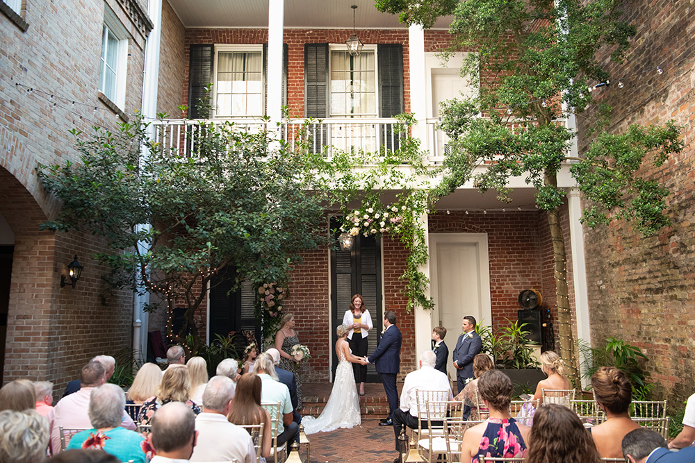 The wedding ceremony took place in the courtyard at Chateau LeMoyne in the French Quarter