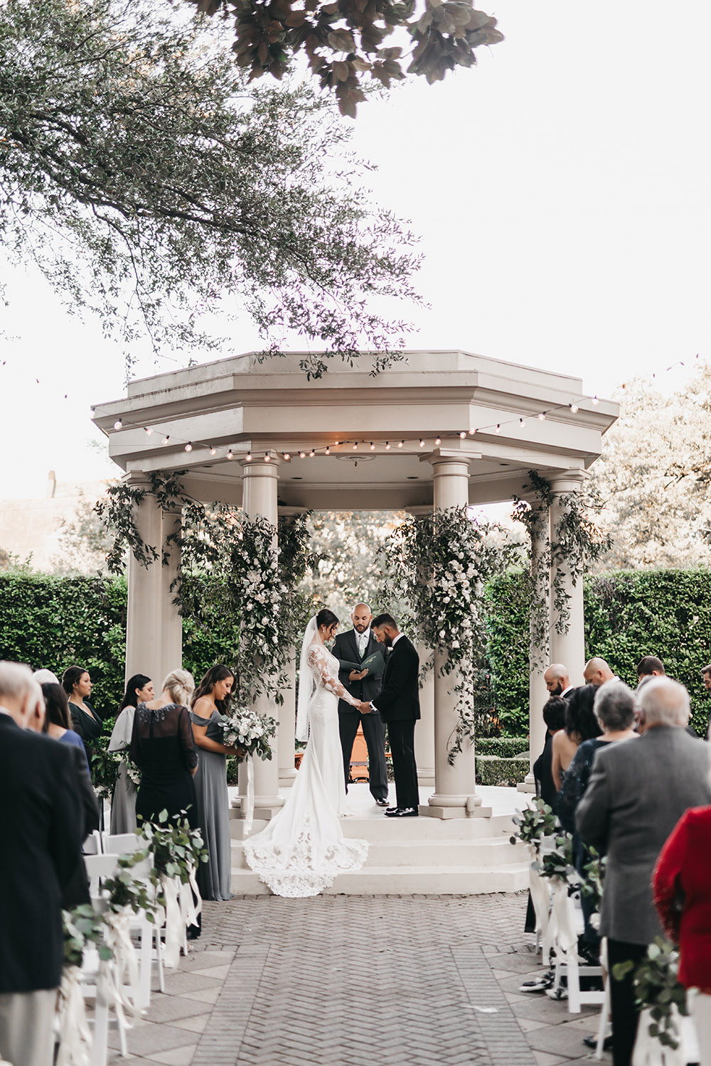 Kimberly and Carlo say their wedding vows in the gazebo at The Elms Mansion