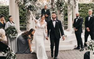 Kimberly and Carlo celebrate as they walk down the aisle