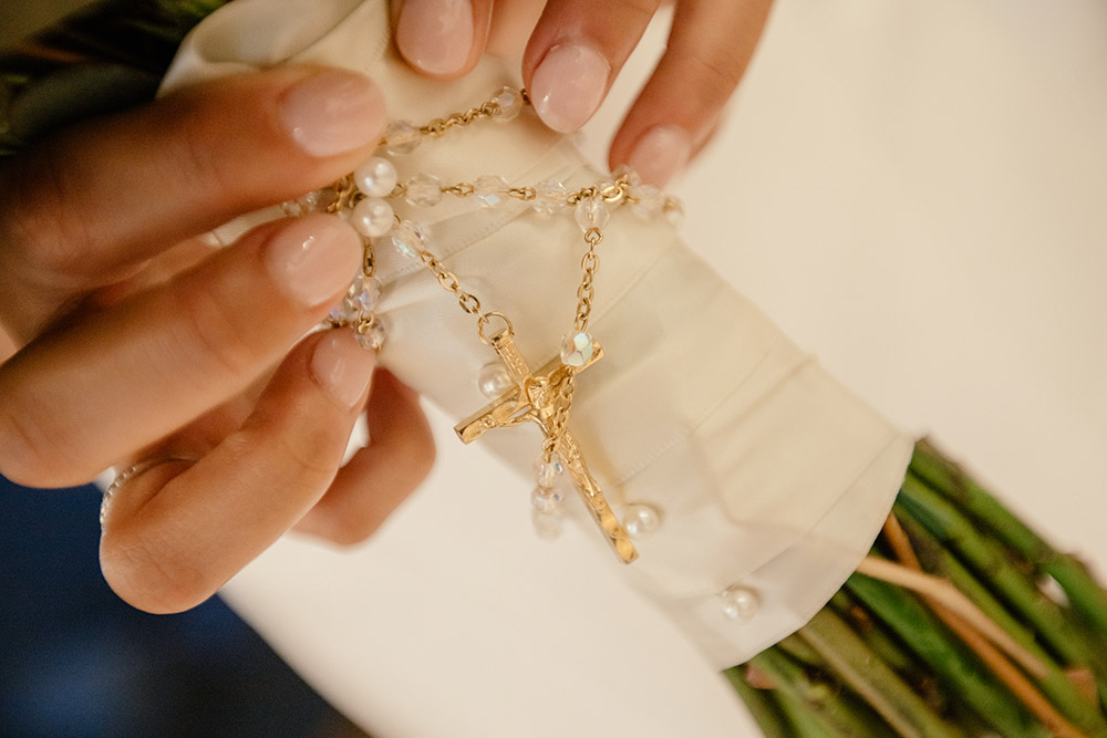 Elizabeth carried the rosary from her First Communion on her wedding day.