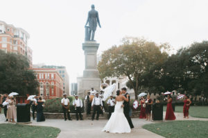 Elizabeth and Jay kiss during their Second Line