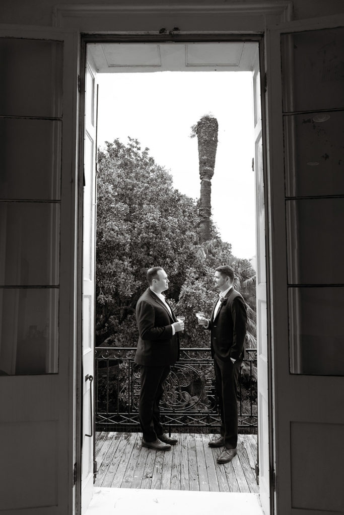 Grooms on a French Quarter balcony by Eau Claire Photographics