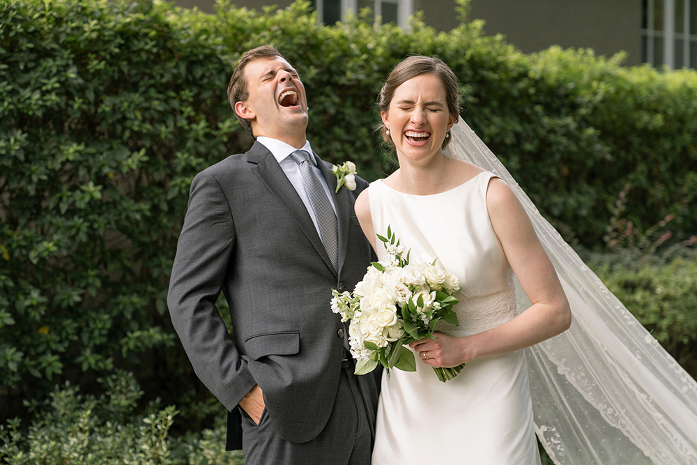 Bride and groom laughing by Eau Claire Photographics