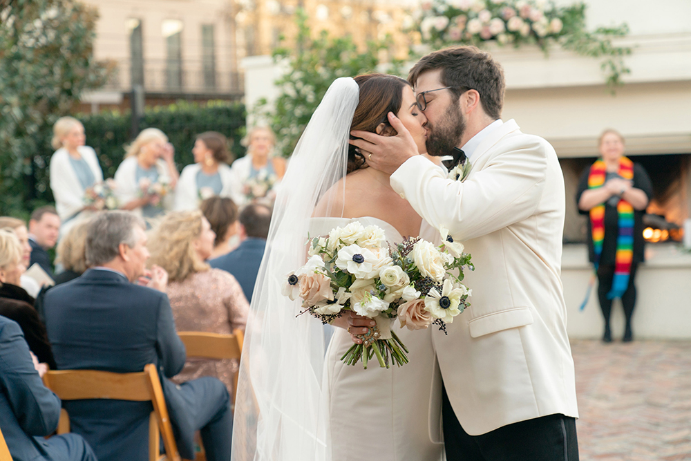 Newlyweds kiss at Il Mercato by Eau Claire Photographics