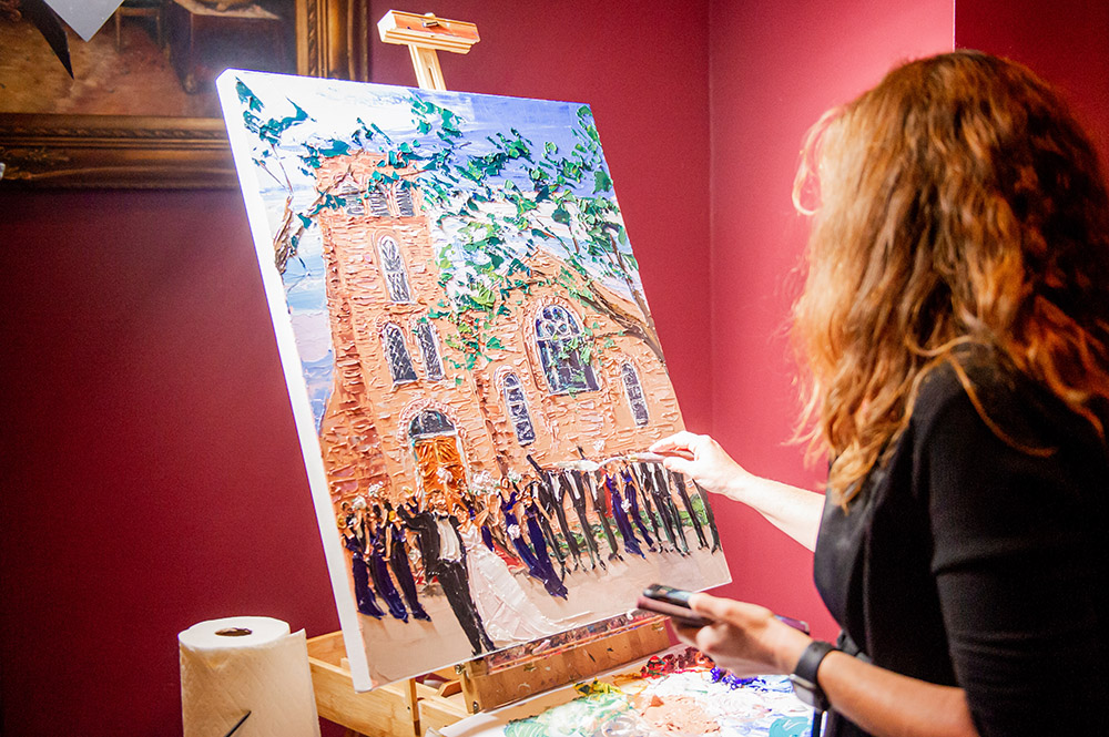 Artist Denise Hopkins paints the wedding.